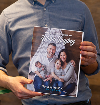 Man holds up Home Buying eBook
